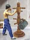 Cartoon: bruce lee (small) by tanerbey tagged bruce,lee,trainning,dummy,cup,holder